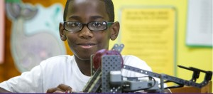 Tyrrek Grizzle poses with a robot he constructed during the robotics summer camp. The camp is part of an ECU partnership that supports elemementary and middle grades students from military families in eastern North Carolina. (Photos by Jay Clark)