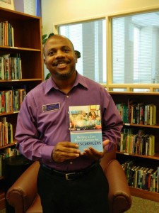 Alan R. Bailey with his newly published book, Building a Core Print Collection for Preschoolers