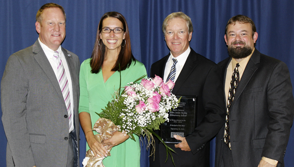 TOP MARKS: Dr. Don Phipps, Superintendent of Beaufort County Schools; Megan Ormond, 2014-2015 BCS Teacher of the Year; Bubs Carson, 2014-2015 Principal of the Year; and Mark Doane, assistant superintendent of Beaufort County Schools at the annual banquet on Sept. 16.