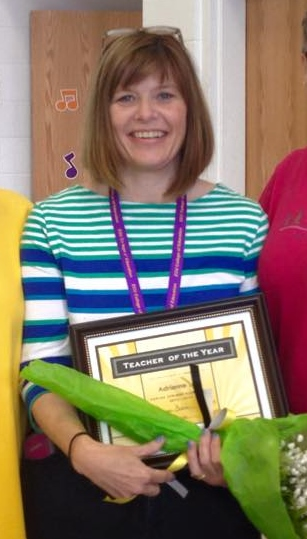 Adrienne Lee displays the Teacher of the Year award she earned as a first-year teacher.