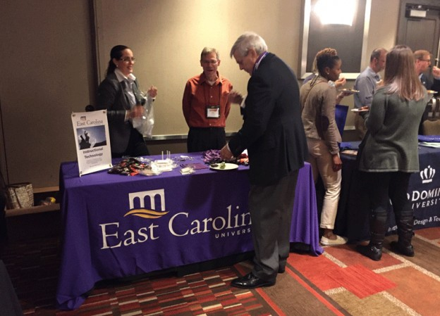 Patricia Slagter Van Tryon and Ken Luterbach welcome AECT Executive Director Phil Harris to the ECU conference reception table.