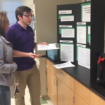 ECU student judges Cody Allen and Amanda Lewis evaluate a student's science project during the First Annual SEADAP Science Fair.