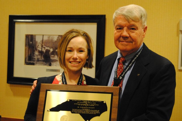 Dr. Liz Fogarty accepting the NCAGT Distinguished Service Award from Dr. Wesley Guthrei, NCAGT Executive Director.