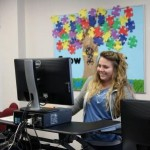Alecia Castellano, a junior Special Education Major, works on the new Varisdesk in the IHAT Center.