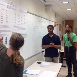 Greene Central High School student Taylor Hill and Pitt County High School students Bishop (BJ) Miles and Lucas Mebane receive feedback on their project