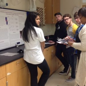 Pitt County High School student Shinjini Misra receives feedback on her project from ECU student judges.