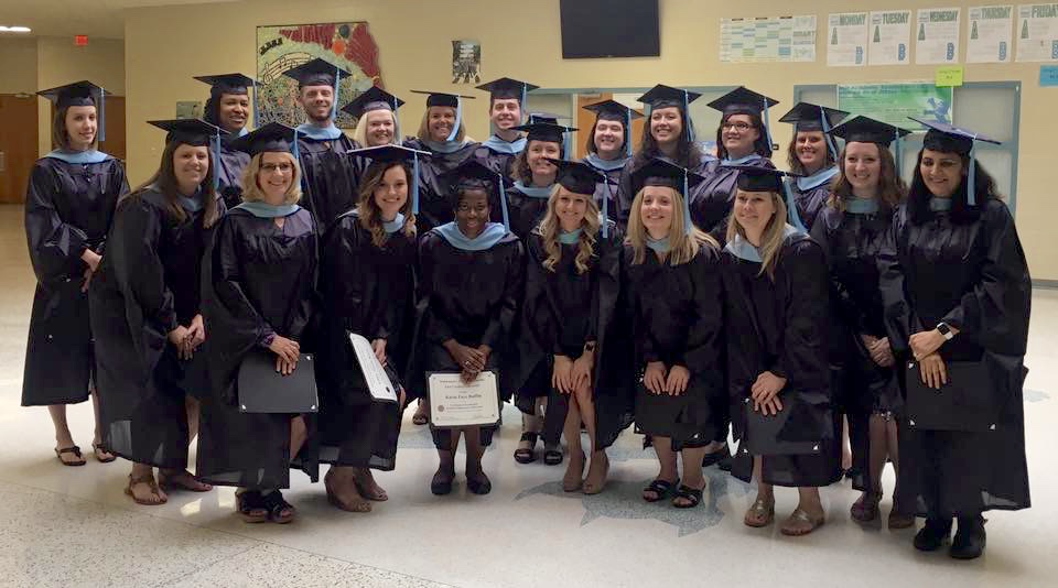 A portion of the 30 high school math teachers that recently earned their master's degrees in education thanks to a unique blend of classes from East Carolina University College of Education.