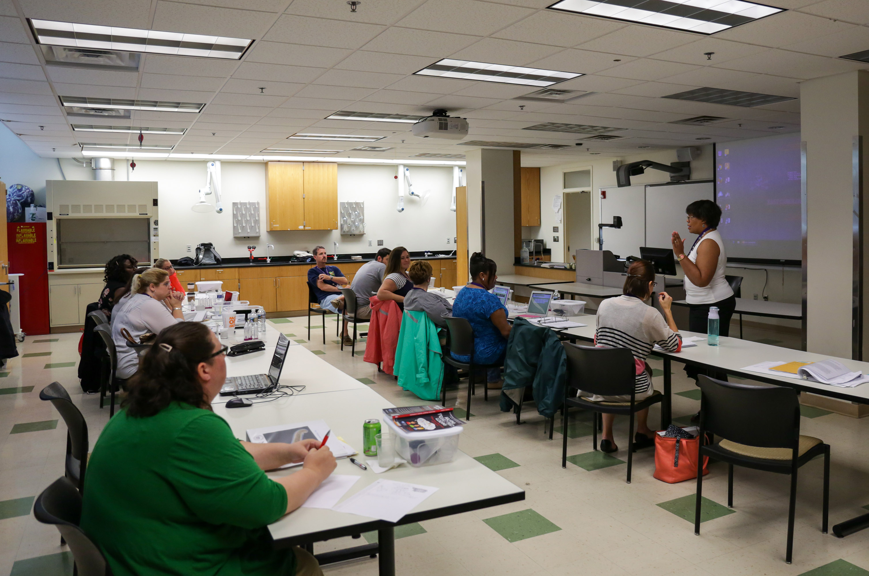 Teachers from five local counties learn a drug dependency exercise to take back to their classrooms during a Science Education Against Drug Abuse Partnership workshop at ECU June 21.