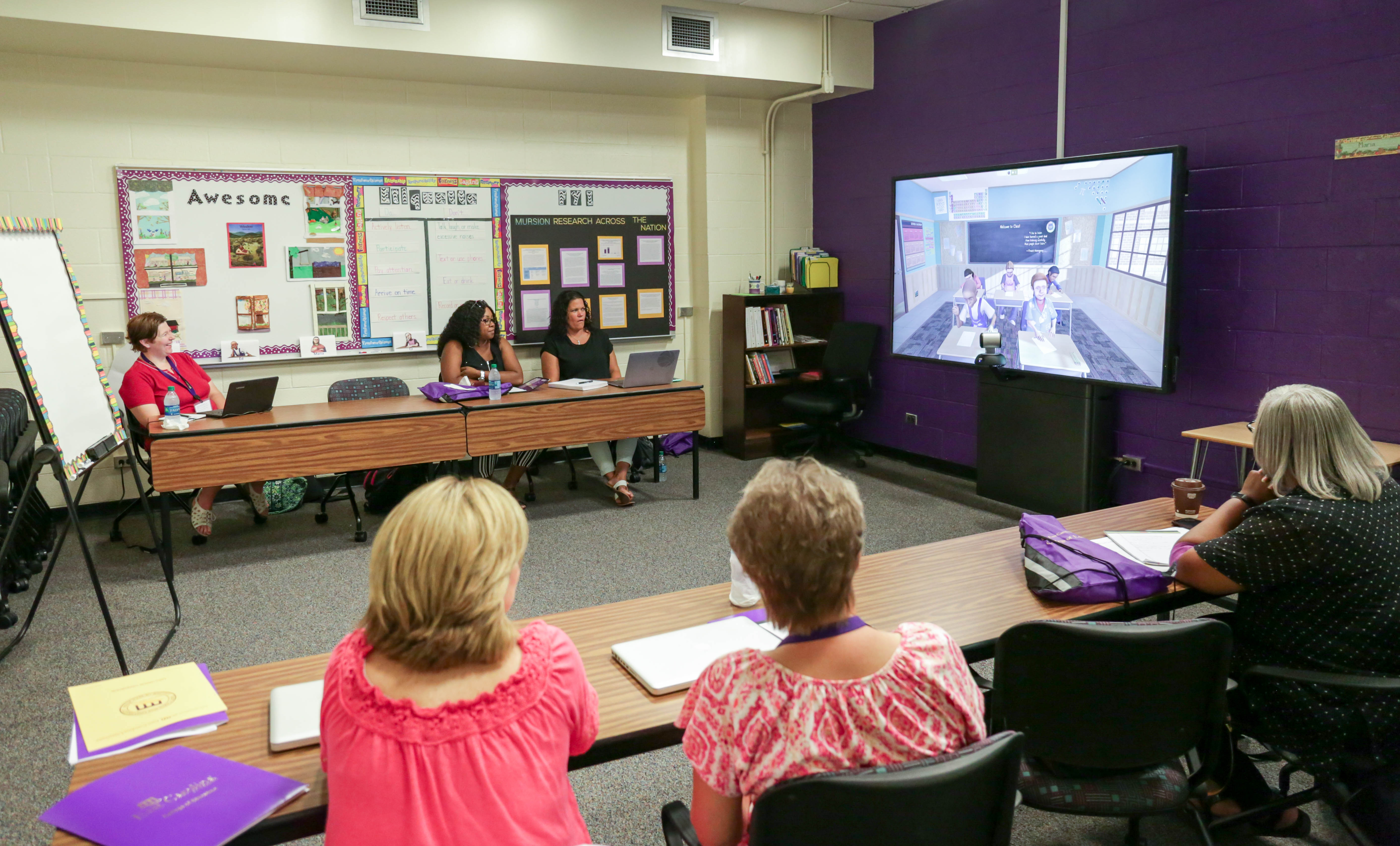 Representatives from eastern North Carolina school districts observe Mursion at work on Thursday, July 27.