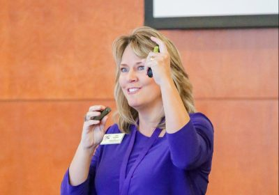 NC Teacher of the Year Lisa Godwin flashes a Pirate hook at the ECU Murphy Center Monday, Oct. 30.