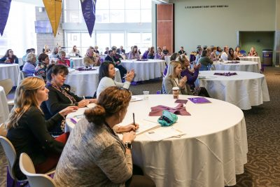 Clinical teacher partners gathered to hear Lisa Godwin speak applaud following her presentation Monday, Oct. 30, at the Murphy Center.