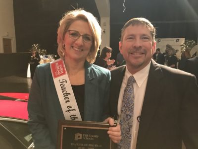 Julie Brickhouse, left, a special education teacher at Wahl Coates Elementary School of the Arts, was named the Pitt County Schools Teacher of the Year on March 14 at Rock Springs Center.