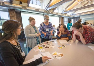 Project CONVEY principal investigator Dr. Sandra Warren, center, speaks with graduate students, from left, Ashton Boyarsky, Allison Skinner, and Samantha Ruppe Beard, who are part of the project's first cohort during the CONVEY summer institute on Tuesday, June 19.