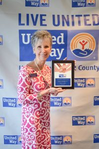 Dr. Terry Atkinson accepts the 2018 Advocacy Award from United Way of Pitt County.