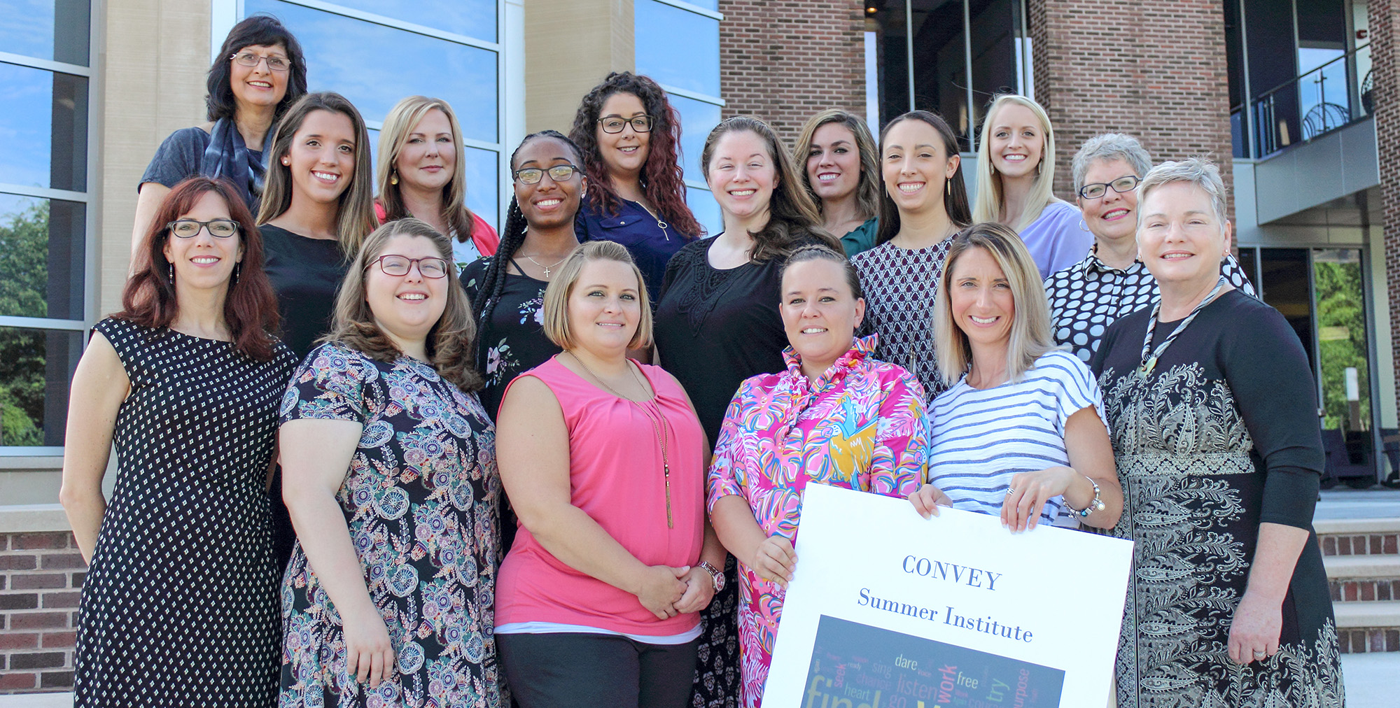 The inaugural class of 12 CONVEY scholars and the leadership team during the program's summer institute at the ECU Health Sciences Student Center.