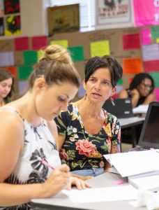 Nicki Griffin, AP Summer Institute consultant South Central High School AP history teacher, and ECU alumnus, guides a fellow AP European history teacher Thursday, June 28.