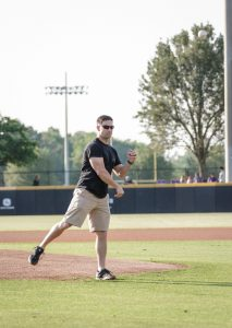 Isaiah Ybarra, a history education major and member of SVRA, throws out the first pitch before the ECU Baseball game on Friday, May 11.