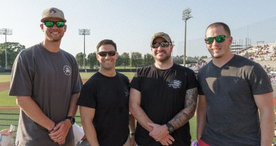 Members of the College of Education Student Veteran Resource Alliance stand with SVRA co-chair Clay Smith, far left, at the ECU Baseball game on Friday, May 11.