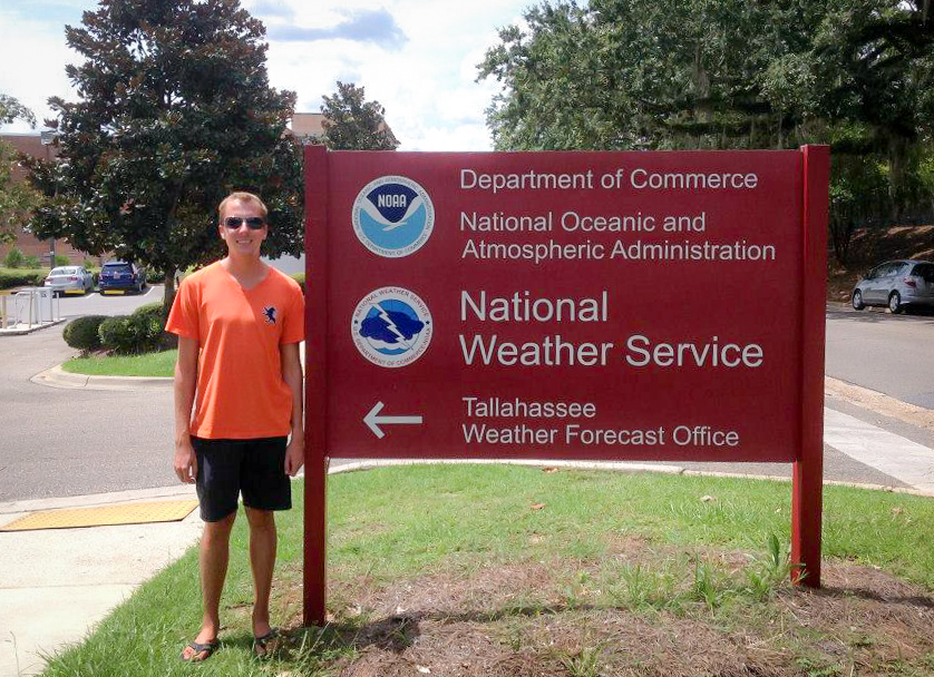 ECU Honors College alumnus Thomas Vaughn (Class of 2015) stands in front of the National Weather Service Station in Tallahassee, Fla. Vaughn will start his career with the NWS this September at the Wichita, Ka. office.