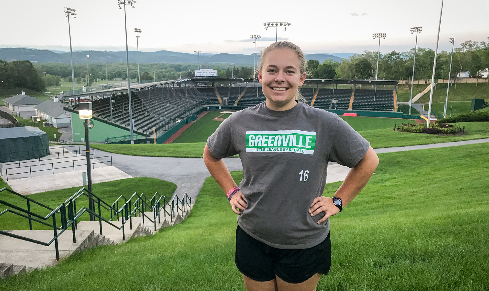Rising Junior Ashely Weingartz stands in front of the Little League World Series complex in Williamsport, Pa., where she is serving as the marketing intern this summer.